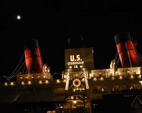 The full-size cruise ship is dry-docked in the resort